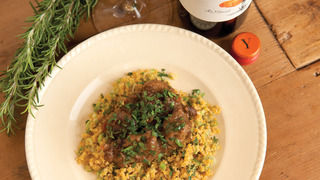 Lamb with Raisins, Bitter Sweet Oranges, Corn Cous Cous, Fresh Herbs and Pan Juices