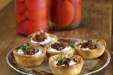 Warm Goats Cheese Tartlet with Preserved Lemon and Currant Chutney